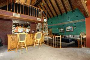 The home has a bunch of extras, including this bar and billiards area.