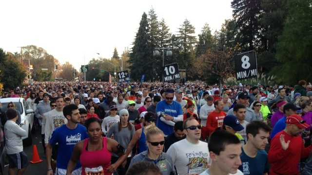 The runners in the 10k Run to Feed the Hungry race take off. (Nov. 28, 2013)