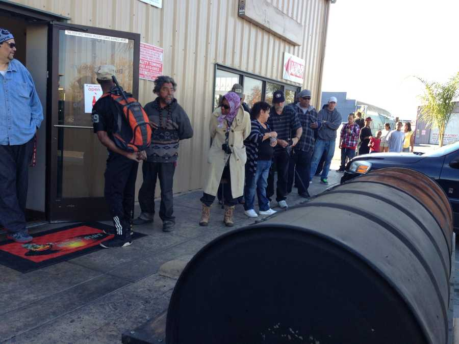 People wait outside Big Ray's Bully Ribs on Martin Luther King, Jr. Boulevard for a free barbecued Thanksgiving meal.