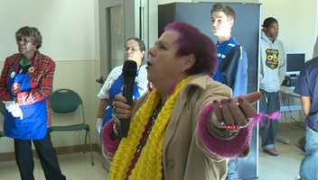 An unidentified woman opens the Salvation Army's Thanksgiving meal by singing a prayer.
