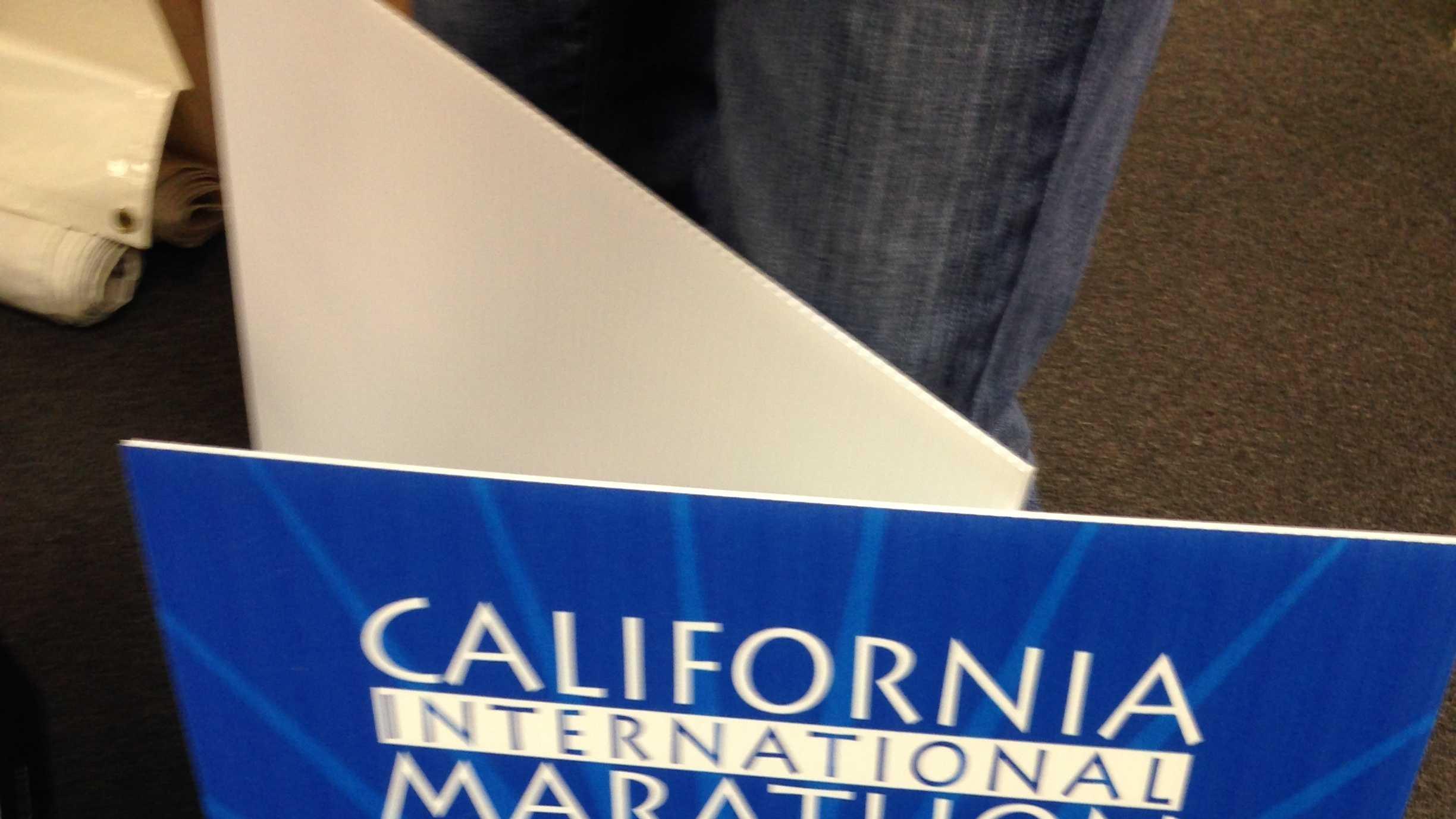 "The Twitter ""hashtag"" for the CIM. These signs will be posted along the route and allow people to check a runner's progress."