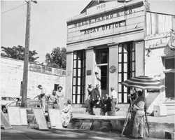 The Wells Fargo and Company assay office on Sutter Street was rebuilt with its original doors, bricks, ceiling joints, granite face and steps. This is a picture from the early to mid-1900s before the building was renovated.