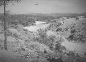 Before construction of the Folsom Dam, the American River flowed freely through the hilly landscape.