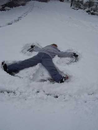 You can brave the cold for a few seconds, get on the ground and create a snow angel.