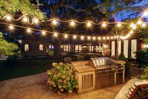 The home has breathtaking gardens centered around a centuries old California live oak.