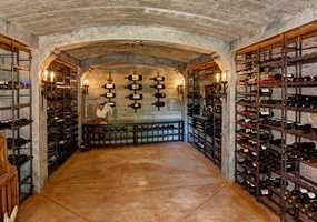 A previously built bomb shelter is a stunning wine cave, large enough to store more than three thousand bottles.