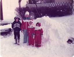 17. My curiosity and passion for weather started when I was young, growing up in New Jersey. I loved big Nor'easter snowstorms that would pile the snow feet high! (I'm in the red snowsuit with yellow flowers. My older sister is the taller one next to me).