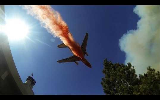 A firefighting DC-10 swoops in over homes near the town of Groveland during the fire fight.
