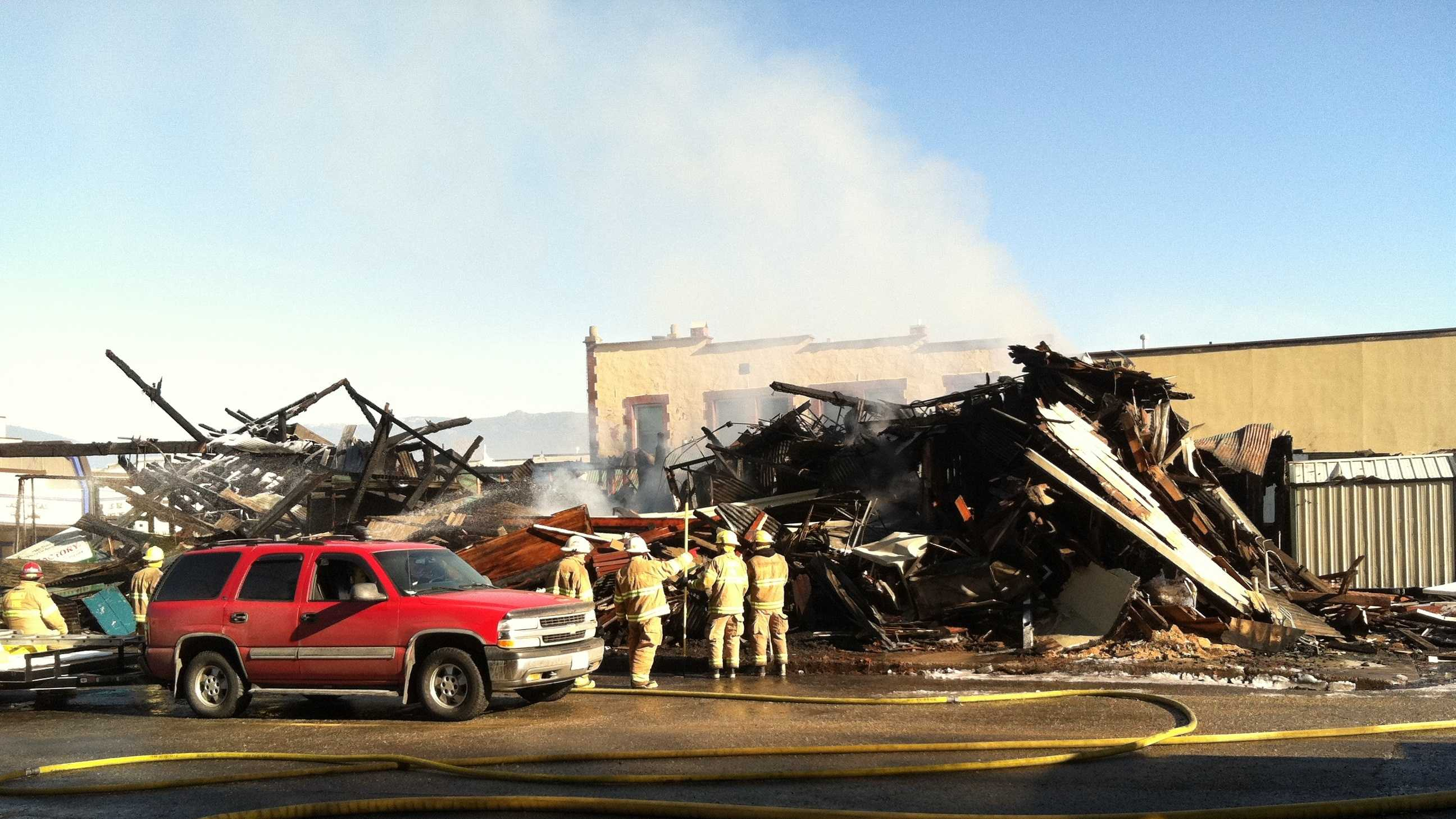 Fire officials said the blaze started around 4 a.m. in the Pizza Factory on Main Street.