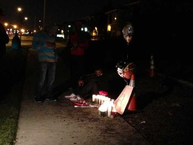 Family and friends of Josh Davis held a vigil Sunday night at the scene where Davis died after his vehicle slammed into a light pole.