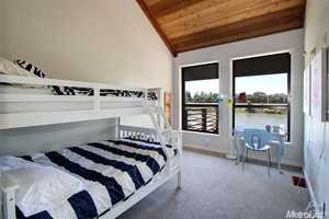 Some of the bedrooms have a suite river view deck and cathedral ceilings.