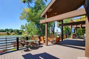 The backyard deck offers a full view of the Sacramento River landscape.