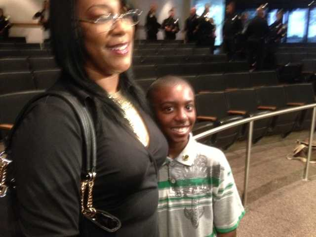 Malik Harvey, 11, with his mother (Dec. 18, 2013).