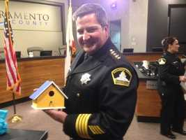 Sheriff Scott Jones shows off the hand-painted bird house (Dec. 18, 2013).