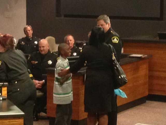 Malik presents the gift to Sacramento County Sheriff Scott Jones (Dec. 18, 2013).