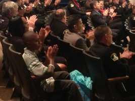Malik Harvey and his mother wait to surprise Sheriff Jones (Dec. 18, 2013).