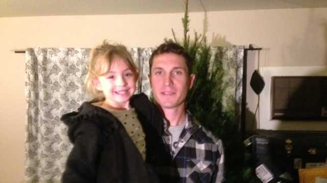 Lodi Army Cpl. Chris Petrossian with his daughter, Cookie (Dec. 23, 2013).