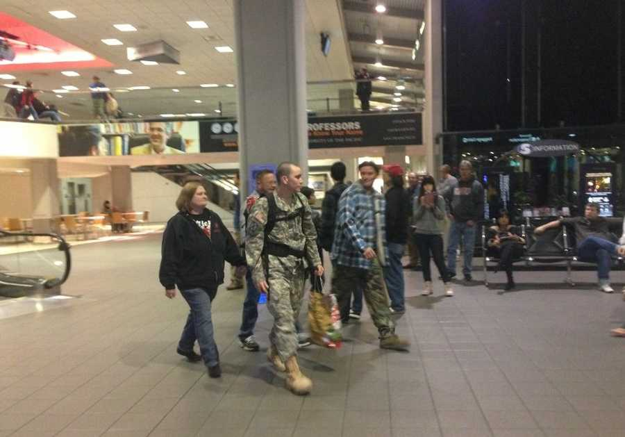 A member of the National Guard walks through Sacramento International Airport after being welcomed home from Afghanistan.
