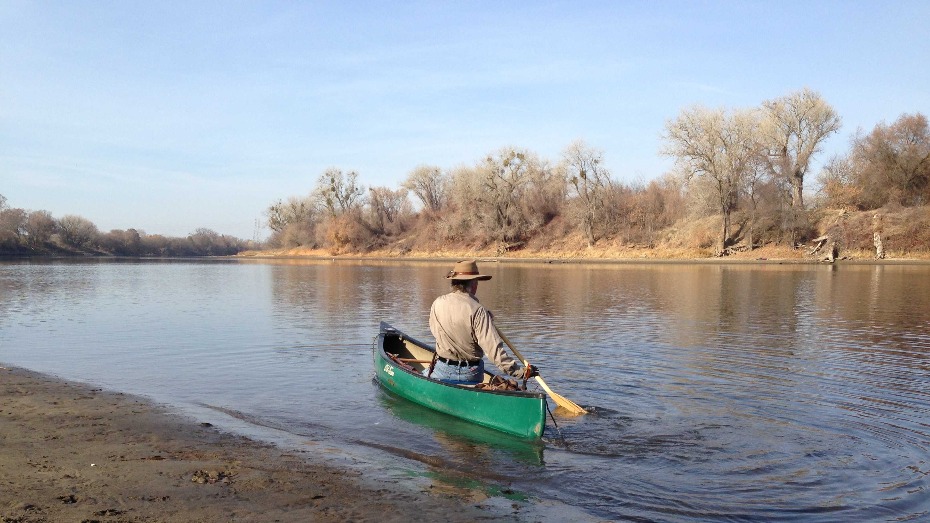 Canoeist Darrell Stone says the low level of the American River causes him to bottom out.