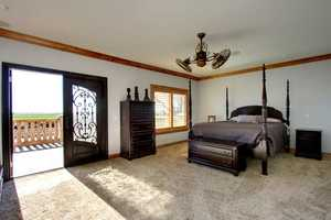 Upstairs is the master suite, which opens up to a spacious balcony with spectacular views of the estate.