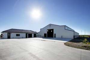 The estate has a main barn featuring 10 run-in stalls, a tack area and multiple cross-ties.