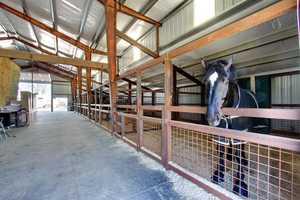 Each stall inside the main barn is 20 feet by 20 feet.