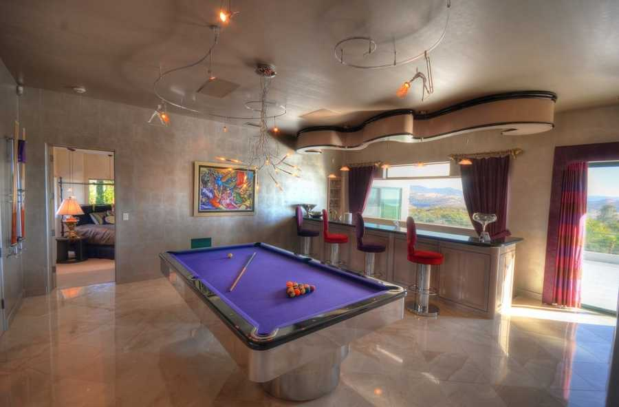 Along with this game room, the home has a 12-seat screening room, arcade parlor and four wet bars.