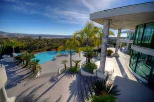 This property affords the homeowner with uninterrupted views of the Sierra Nevada mountains, Folsom Lake and the Sacramento skyline.