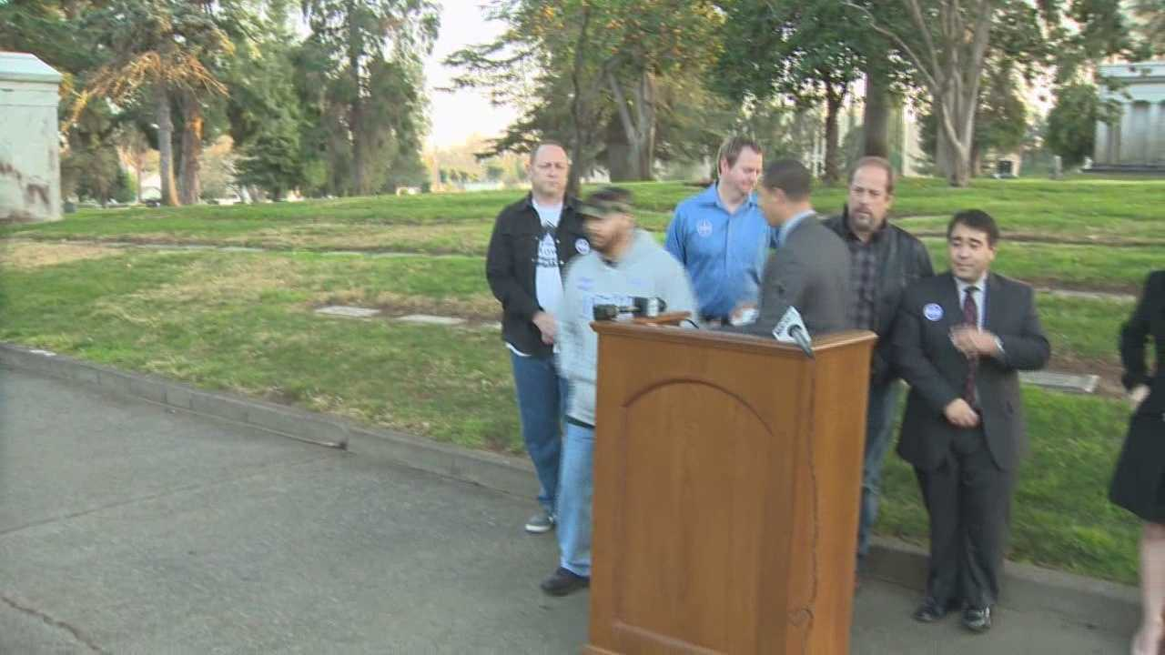Pro downtown arena group holds press conference in cemetary