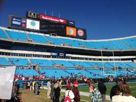 Fans start to trickle into Bank of America Stadium before Sunday's game.