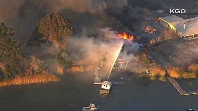 Coast Guard crews and firefighters were battling a large fire that broke out Tuesday on Kimball Island, near the Antioch Marina.