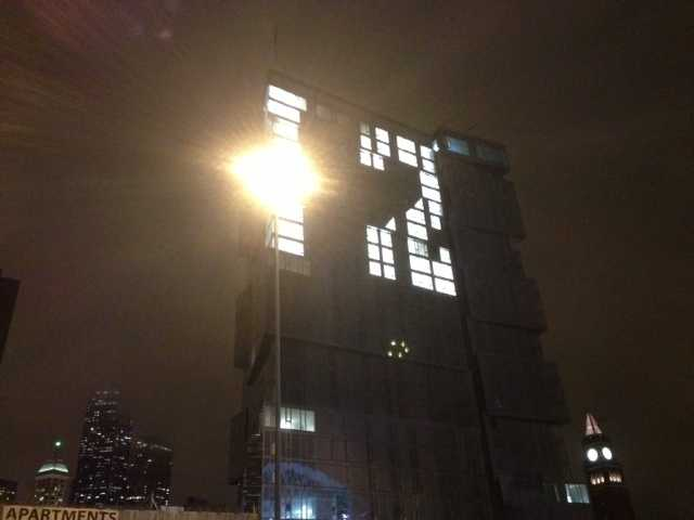 """The No. 12 is lit up on a building in downtown Seattle. The number is in reference to Seattle's """"12th man"""" crowd at CenturyLink field."""