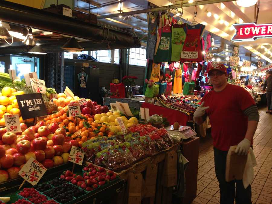 A 49ers fan poses at the famous Pike Place Market in Seattle.