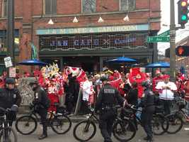 49er fans gather around in Seattle with lots of police presence as they await the NFC Championship game.