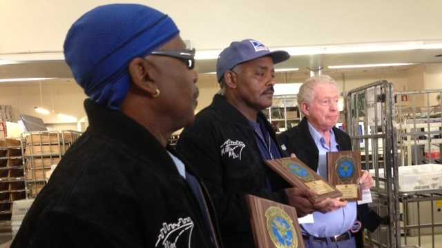 Alphonso Simmons, Thomas Haselrig and Robert Cary accept commemorative plaques for reaching million mile mark.