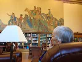 A patron sits and enjoys the newly renovated Stanley Mosk Library.