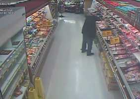 The Oakland Police Department released surveillance of the suspect in the carjacking and kidnapping that prompted an Amber Alert on Tuesday in Lincoln Square Shopping Center. The man is seen walking down a meat aisle.