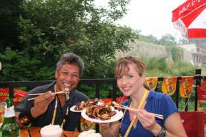 Deirdre and Domi enjoyed eating local food as they reported from Beijing for the 2008 Summer Olympics.