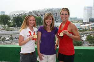 KCRA's Deirdre Fitzpatrick posed in Beijing with members of the USA women's rowing team.