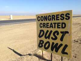 Signs in Fresno County blame the drought on lawmakers.