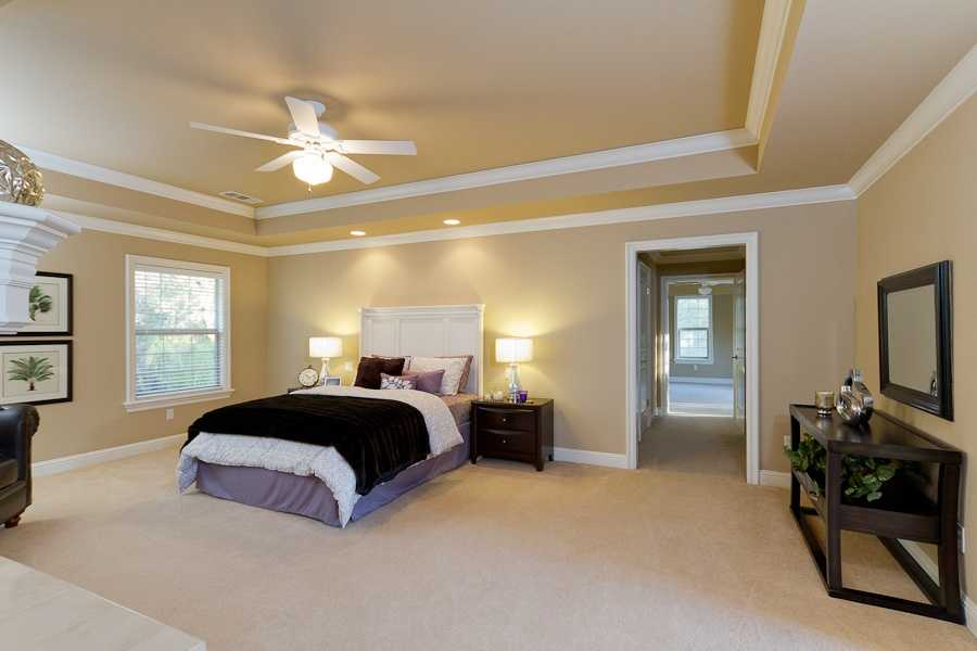 Inside the master suite you'll find: a fireplace, his and her walk-in closets and private sitting room with plenty of storage.