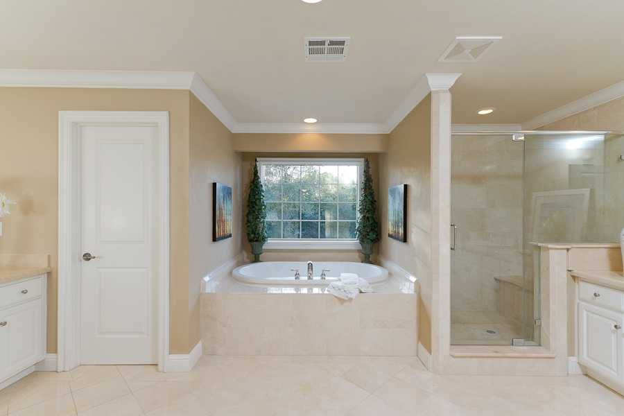 The bedroom has this spacious bathroom.