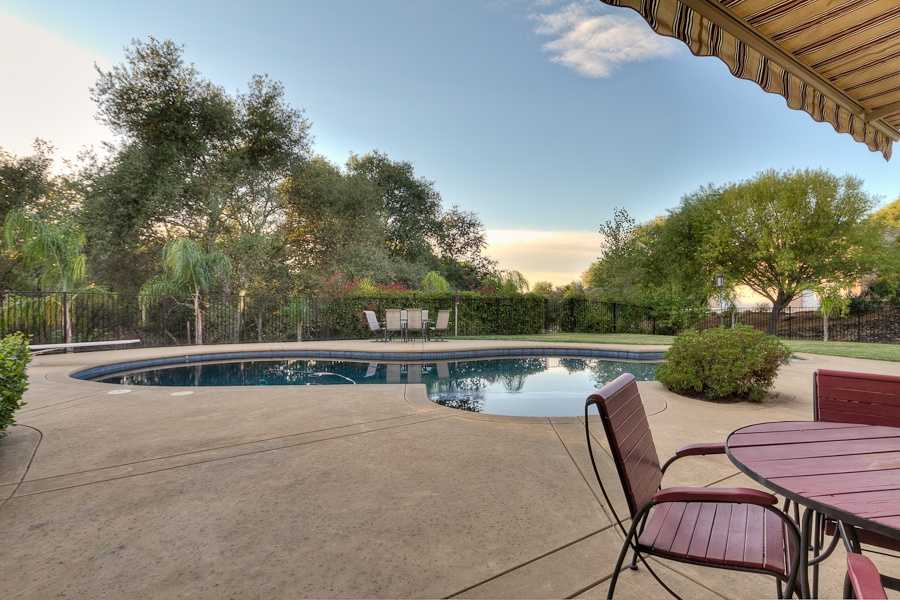The home offers the opportunity to entertain in the outdoors around a sparkling pool and spa.