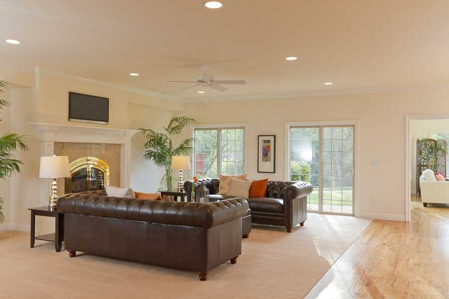 The cozy family room is complete with wood burning fireplace.