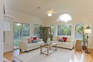 Let there be light. This sun room off the informal dining room area has a cozy fireplace.