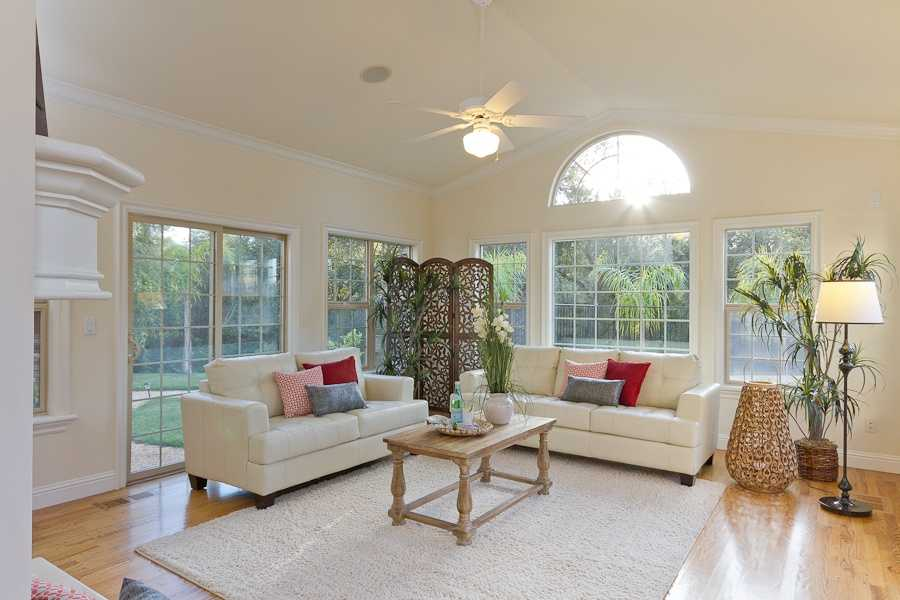 Let there be light.This sun room off the informal dining room area has acozy fireplace.