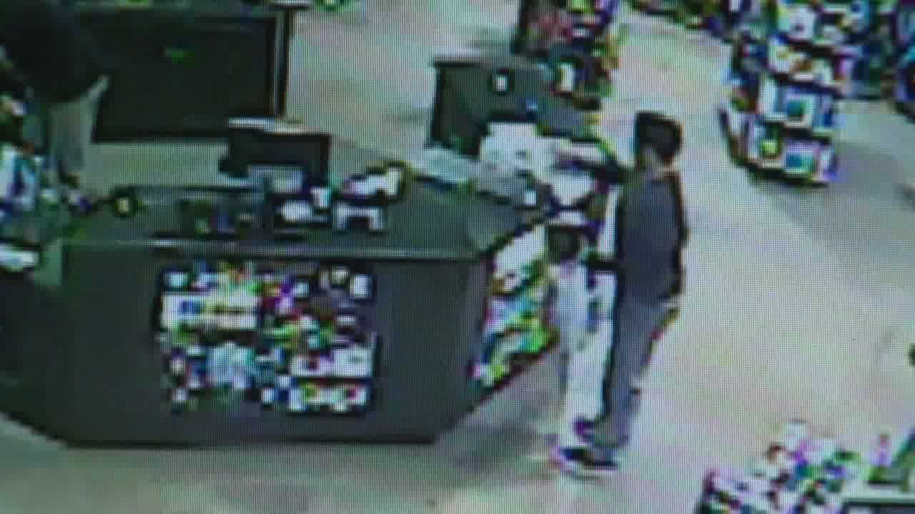 An attentive store clerk helped police catch and arrest an identity thief in the act.