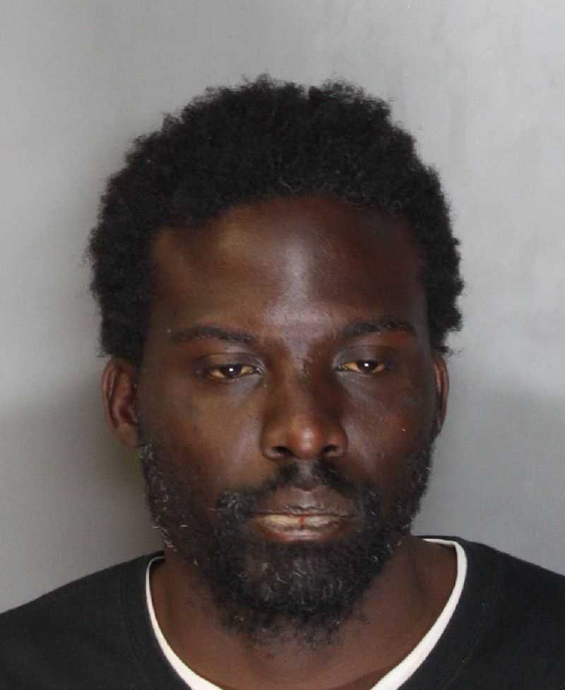 Lemar Burleson, 35, was arrested on suspicion of touching himself inappropriately inside a business, police said.