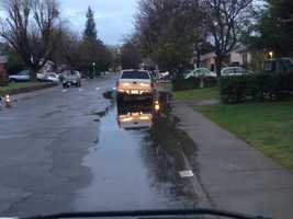 Rain causes some street flooding in Sacramento near Fruitridge Road.