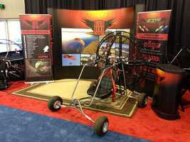 The show is more than just boats. It includes RVs and this flying chair on wheels!